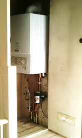 Combination boiler installed in airing cupboard.