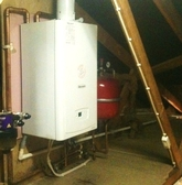 Glow-worm system boiler installed in attic.