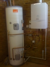 Vaillant boiler installation together with mega flow situated in garage.