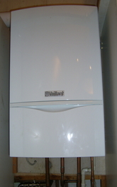Vaillant combination boiler installation in kitchen cupboard.