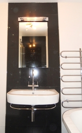 Wall hung sink with towel rail.