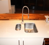 Kitchen sink installation with marble work top.