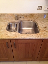 Kitchen sink installation on marble work top.