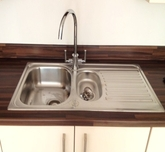 Kitchen sink installation hard wood work top.