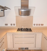 Gas hob installation in granite work surface.