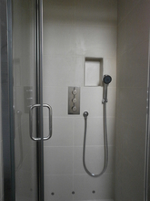Shower installation with low level lighting.